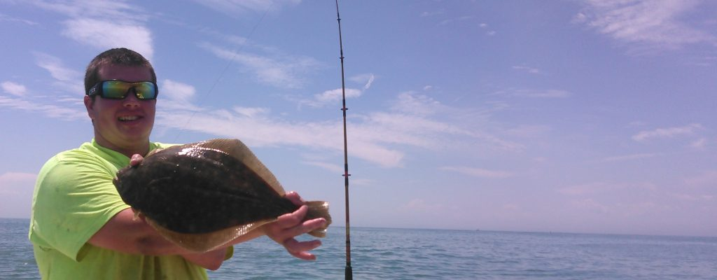 A Fisherman Holds A Flounder, Taken Off Of The Southern New Jersey Coast Near Tuckerton, New Jersey